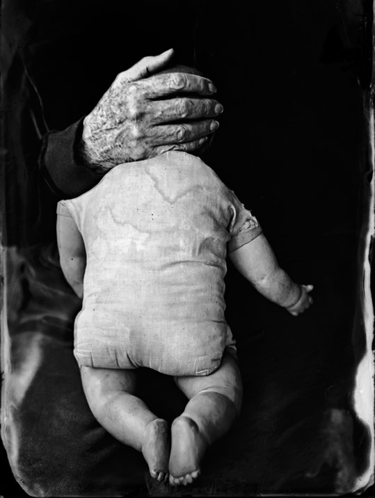 Briechle-2006-doll-with-old-hand-covering-head